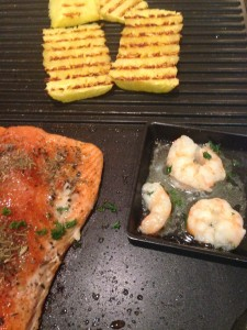 salmon, shrimp and pineapple on raclette grill