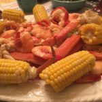 Seafood boil with shrimp, crab, lobster and corn.