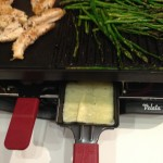 While grilling chicken and asparagus, we melted cheese in a raclette pan.