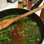 Getting started with French beans in the pan with garlic, ginger and green onions