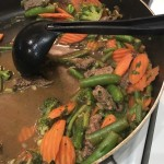 Veggies cooking in broth with spices