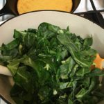 Collard greens greeting the pancetta before entering the slow cooker