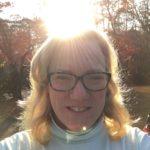 Woman standing in autumn sunshine