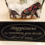 Craft sign with inspirational wording about happiness
