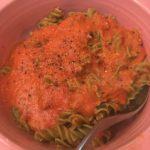 Veggie rotini with veggie sauce in a bowl.