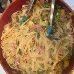 Bowl of fettucini with ham and vegetables.